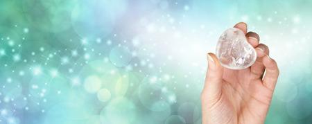 Crystal healing banner with bokeh green background Foto de archivo