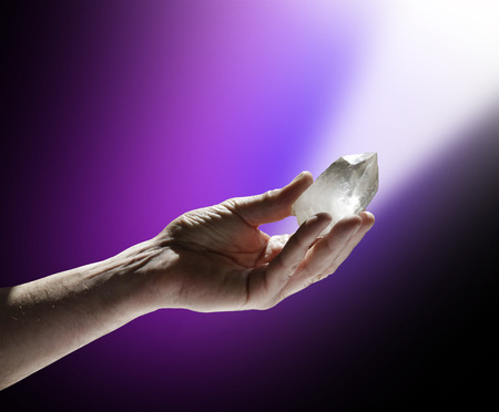 Charging Quartz Wand in Magenta White Light Stock Photo