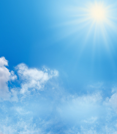 Blue sky fluffly clouds and sunshine background