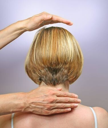 Demonstrating hand positions for channeling healing photo