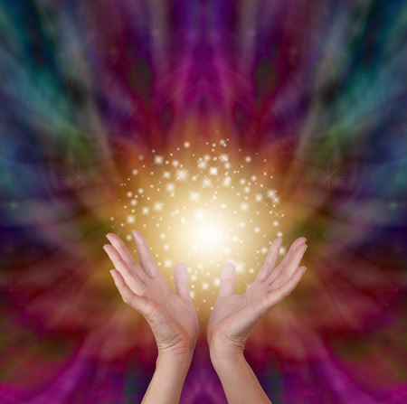 color healing: Magical healing energy on radiating color background