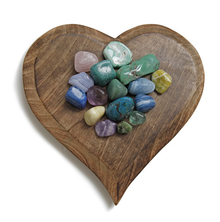 color healing: Chakra Crystal tumbled stones on wooden heart plaque Stock Photo