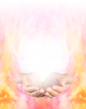 Sensing Golden Healing Energy  Female cupped hands on a golden energy formation background graduating to white at the top providing plenty of copy space