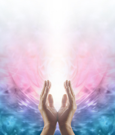 Beaming Reiki Healing Energy  Male parallel hands facing upwards with a beam of bright white energy flowing up on a pink and blue ethereal energy formation background