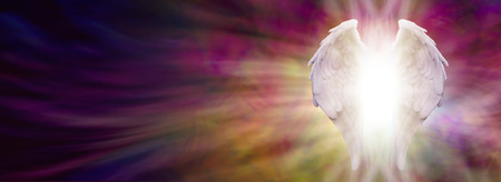 spiritual background: Angel Wings and Healing Light Banner - White Angel wings with bright light beaming outwards from between on an ethereal warm rich colored pink and gold energy formation background