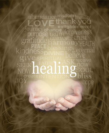 the shaman: Gentle Healing Words - Female cupped hands with the word healing floating above surrounded by a healing word cloud on a swirling misty sepia colored energy background Stock Photo