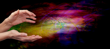 universal enlightenment: Psychic healing energy field - Female outstretched healing hands on psychedelic multi colored flowing energy formation background