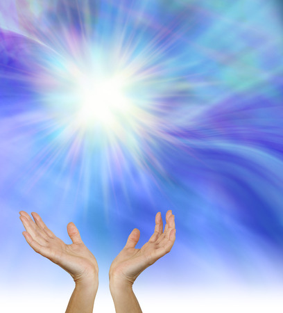 spiritual energy: Spirit of Life - Female healing hands outstretched upwards towards a stunning white star formation on a blue energy field background Stock Photo