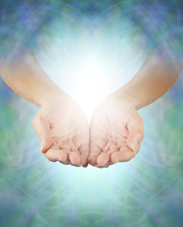 color healing: Sharing Divine Healing Energy - Female healing hands emerging from an intricate blue-green energy background cupped offering misty white energy