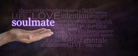 soul mate: Seeking a Soulmate - male hand palm up with the word Soulmate floating above, surrounded by a word cloud on a deep purple stone effect wide background Stock Photo