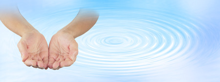 ripple effect: Water Healing Therapist - Female open cupped hands on a pale blue water ripple effect background with plenty of copy space