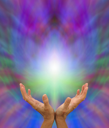 healing chi spiritual: Sending Distant Healing - Healers open hands sending distant healing with light white energy formation above on a multicolored background and plenty of copy space