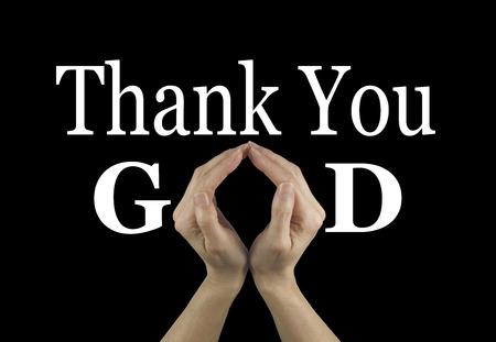Dank u God - vrouwelijke handen maken van een 'O' vorm in het woord GOD op een zwarte achtergrond met dank u hierboven Stockfoto