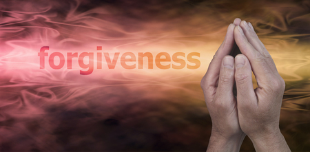the righteous: Please Forgive Me - Male hands in prayer position on a wide golden streaming background with the word Forgiveness to the left and plenty of copy space beneath Stock Photo