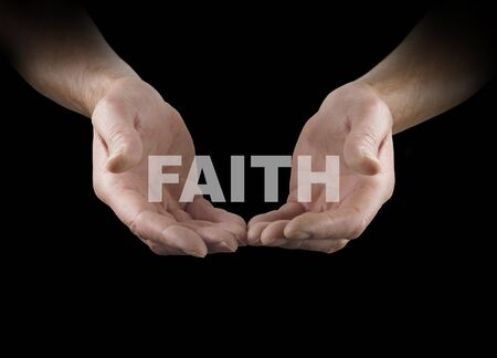 make belief: Have a little Faith - pair of male hands held in an open gesture with the word FAITH floating above on a black background Stock Photo