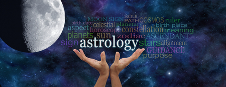 ascendant: It is written in the Stars - Astrology Banner - deep space dark blue background with a large moon on left and a pair of female hands reaching up to the word ASTROLOGY surrounded by a word cloud Stock Photo