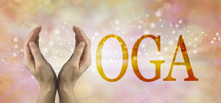 oneness: Offering Yoga Header - Female using both hands to make the Y in the word YOGA on a warm golden  colored starry background
