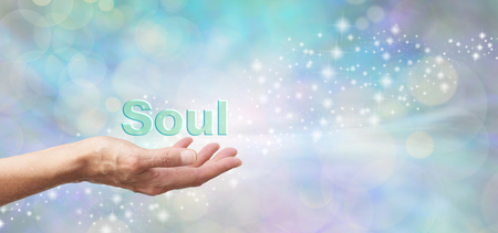 family practitioner: Loving Vigil of a Soul - Female with outstretched hand palm facing up and the word SOUL hovering above on an ethereal green blue bokeh and sparkles background and white light