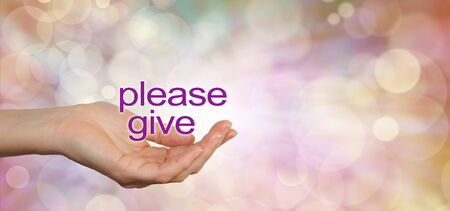 needy: Please give charity campaign banner - wide banner with a womans cupped hand in a needy gesture with the words Please Give floating above on a warm colored bokeh background and copy space on right Stock Photo
