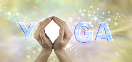 Offering Yoga Header - Female using both hands to make an O in the word YOGA on a subtle natural colored starry energy formation background Stock Photo