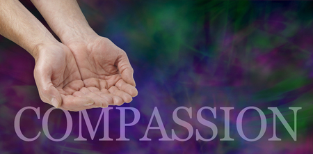 needy: Compassion banner -  wide banner with a mans hands in a cupped needy position and the word COMPASSION below on a dark green and purple modern  background with copy space in the upper right area