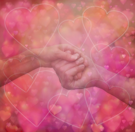 soul mate: Loving Touch - Semi transparent man and woman tenderly holding hands on a background of red and pink love hearts with plenty of copy space, ideal for a valentine, wedding or engagement theme