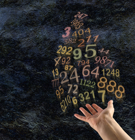 decode: The Art of Numerology - Female hand palm up with a group of random gold transparent numbers floating up and away on a dark rustic stone effect background with copy space on the left