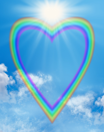 copys pace: A large empty rainbow shaped heart creating a frame on a blue sky background