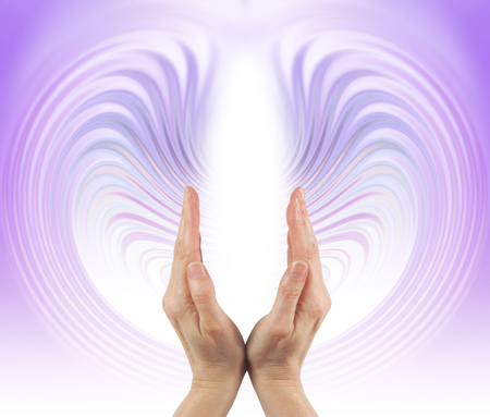 prana: Eternal Energy Streaming - Healing hands pointing upwards with a lilac energy formation streaming up and around the hands and a central white energy center with plenty of copy space