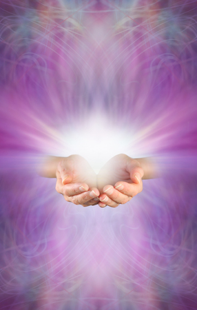 chi healer: Receiving a Reiki Attunement - female cupped hands with burst of white energy above on a beautiful intricate feminine purple pink energy formation background with plenty of copy space