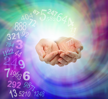 Ask a Numerologist for guidance - female cupped hands emerging from an ethereal multicolored spiraling energy field and a swirl of random numbers coming into her hands with copy space