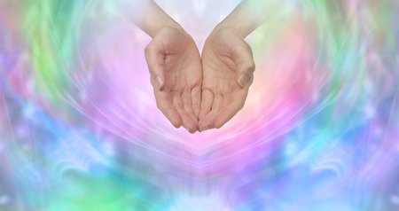 in need of space: Ask and it is Given - female cupped hands emerging from a wispy pastel colored background with plenty of copy space ideal for a fundraising campaign Stock Photo