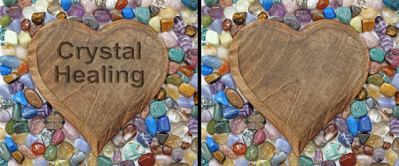 crystal healing: Crystal Healing Plaque - two identical images of a wooden heart plaque surrounded by multicolored tumbled stone crystals on saying Crystal Healing Stock Photo