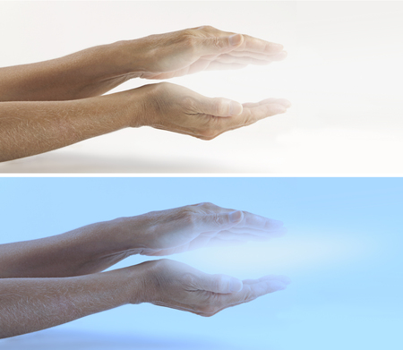 healing chi spiritual: Beaming Reiki Healing Energy x 2 banners   Pair of female hands held parallel on a light and on a blue background with white energy between palms