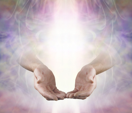 healing chi spiritual: Offering You Angelic Love and Healing - male open hands emerging from beautiful muted color energy field background with a shaft of white light and plenty of copy space above