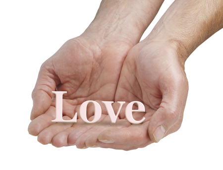 soulful: Offering you pure love - male cupped hands offering the word LOVE floating just above his fingers, isolated on a white background