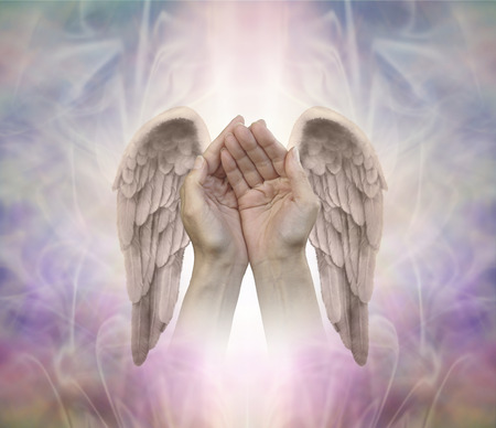 angelic: Angelic helping hands - cupped hands with finely detailed Angel wings on either side, on an intricate ethereal patterned background with a central light shaft and copy space