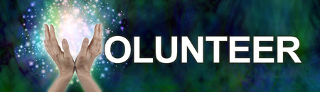 give out: Put your sparkle into Volunteering -  wide banner with a womans hands in an open position making the V of  the word VOLUNTEER on a dark green blue wide background with sparkles behind