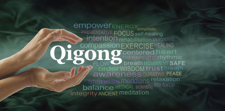 qigong: Qigong word cloud and healing hands - female cupped hands with the word QIGONG between surrounded by word cloud on a flowing green light and dark background