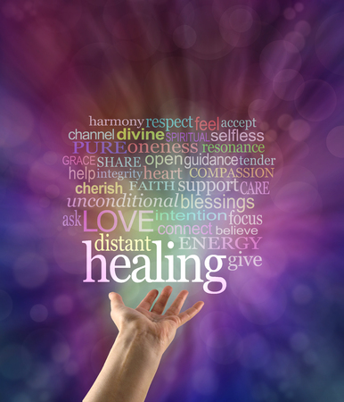Sending out beautiful healing intention - female hand palm up with a large HEALING word floating above and a word cloud on an outward flowing magenta blue bokeh background