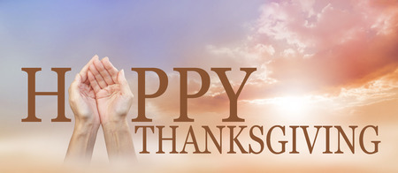 give: Sharing a Happy Thanksgiving -  wide autumnal sunset sky background with a pair of cupped female hands making the A of HAPPY with THANKSGIVING below and copy space above