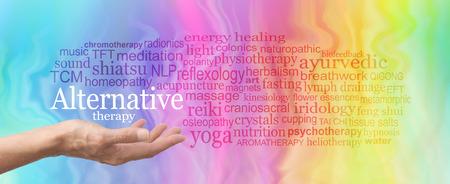 Alternative Behandlungsmethode Word Cloud - weibliche Hand gehalten Palm die Worte Alternativmedizin in Weiß oben durch eine entsprechende Wortwolke nach oben auf einem Regenbogen umgeben farbigen Marmor-Effekt Hintergrund Standard-Bild - 62352270