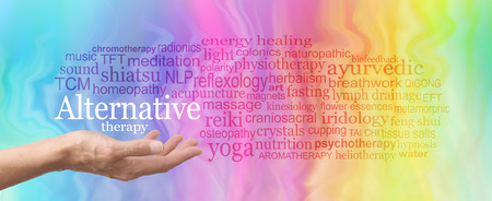 Alternative Therapy Word Cloud - female hand held palm up the words ALTERNATIVE THERAPY in white above surrounded by a relevant word cloud on a rainbow colored marble effect background Foto de archivo