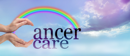 bridging: Gentle Cancer Care - female hands making the C of CANCER CARE on a beautiful evening light cloud landscape with a rainbow bridging from the hands to the r of cancer with copy space beneath Stock Photo