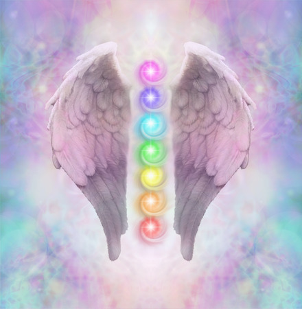 Angelic Sacred Chakras - Angel wings with seven chakras floating between an ethereal pastel colored delicate energy background