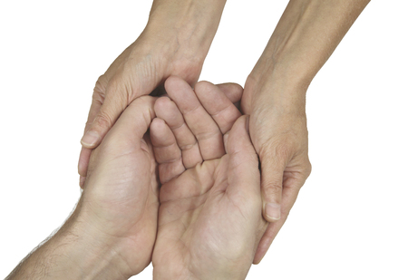 needy: Compassionate Carer  -   womans hands gently holding a mans cupped hands in a needy gesture isolated on a white background