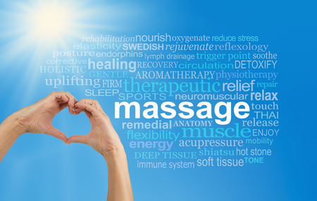 Love Massage word cloud - female hands making a heart shape with a MASSAGE word cloud on the right, blue sky background and bright sun burst in top left corner Archivio Fotografico