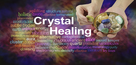 Crystal healing word cloud - female crystal therapist offering yellow stone from a selection of crystals in a brass dish, surrounded by a relevant word cloud on a vibrant multicolored background Banque d'images