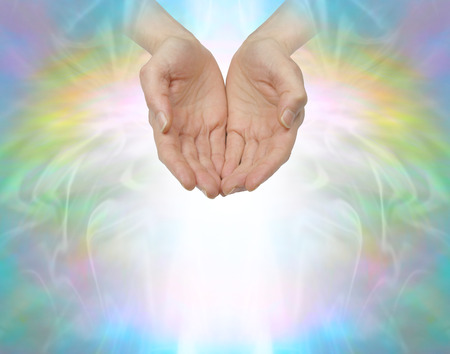 prana: Ask Believe Receive - female with hands in cupped position on a beautiful angelic ethereal rainbow colored background with plenty of copy space below