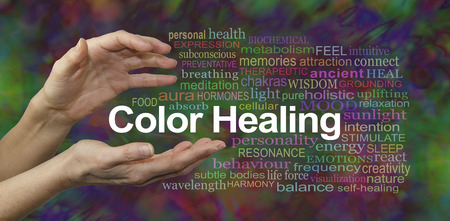 website words: Color Healing Therapy Website Banner  -  Female hands sensing the words COLOR HEALING surrounded by a relevant word cloud on a multicolored background Stock Photo